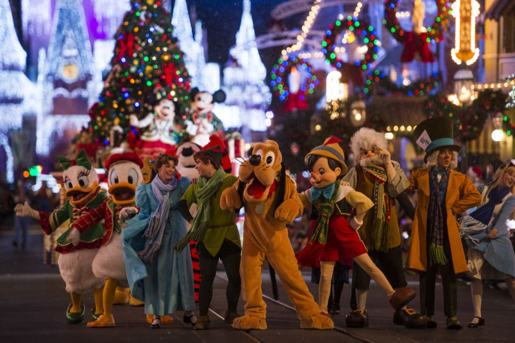 """Disney characters dressed in their holiday finest parade down Main Street, U.S.A., at Magic Kingdom during """"Mickey's Once Upon a Christmastime Parade."""" The festive processional is one of the happy highlights of Mickey's Very Merry Christmas Party, a night of holiday splendor with lively stage shows, a unique holiday parade, Holiday Wishes: Celebrate the Spirit of the Season nighttime fireworks, and snow flurries on Main Street, U.S.A. The special-ticket event takes place on select nights in November and December in Magic Kingdom at Walt Disney World Resort in Lake Buena Vista, Fla. (Charlie Champagne, photographer)"""