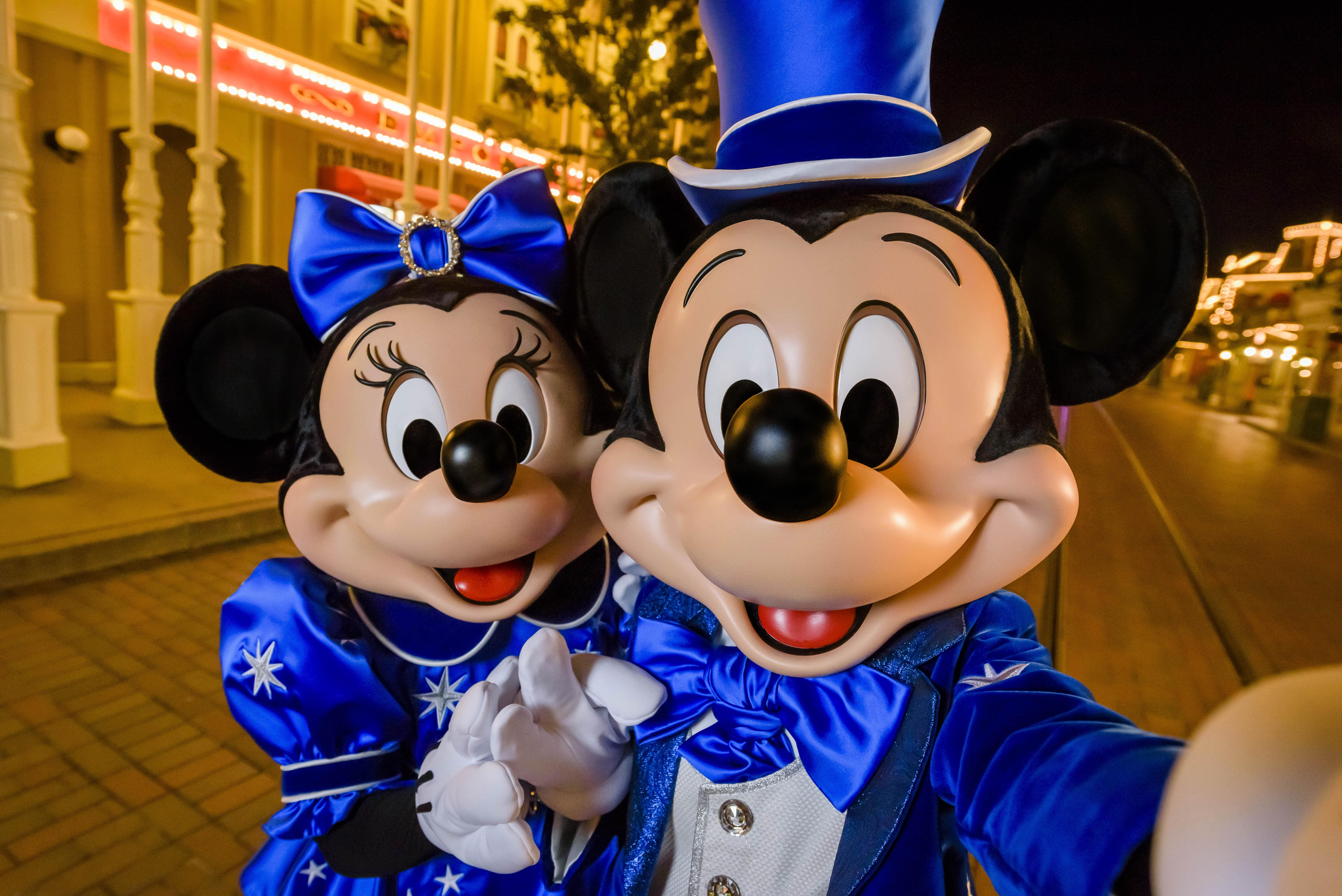 Mickey and Minnie appear in their 25th anniversary outfit