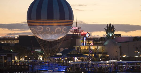 Characters in Flight balloon soars above Disney Springs in Lake Buena Vista, Fla. The tethered helium balloon features a fresh design inspired by the springs and the element of water. From 400 ft. up in the air, guests get a breathtaking 360-degree view of Walt Disney World Resort for approximately 8 - 10 minutes. The daily hours of operation are 8:30 a.m. to midnight, weather permitting. (David Roark, photographer)