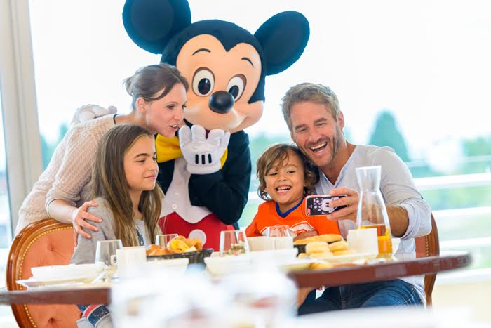 Image result for family in a restaurant at disneyland paris
