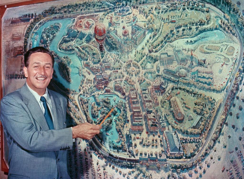 Walt Disney in front of a map of Disneyland, Anaheim