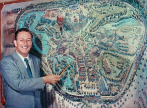Walt Disney in front of a map of Disneyland, Anaheim